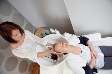 Woman Receiving Head Massage in Beauty Salon