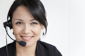 Mixed race businesswoman in headset