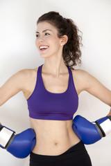Smiling woman wearing boxing gloves