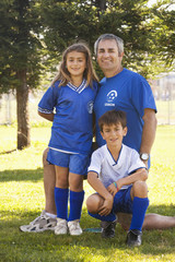 Father with children in soccer uniform