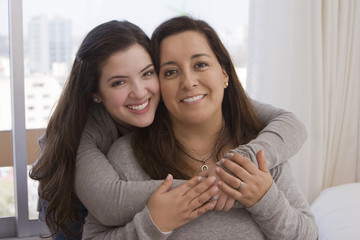Chilean daughter hugging mother