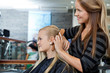 Hairdresser Combing Hair Of Female