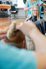 Female Customer Getting Hairdo At Salon
