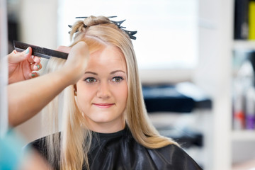 Woman Getting Hair Combed