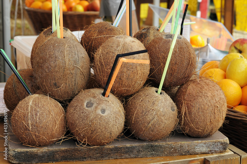 Coconuts on tray decorating a picnic table