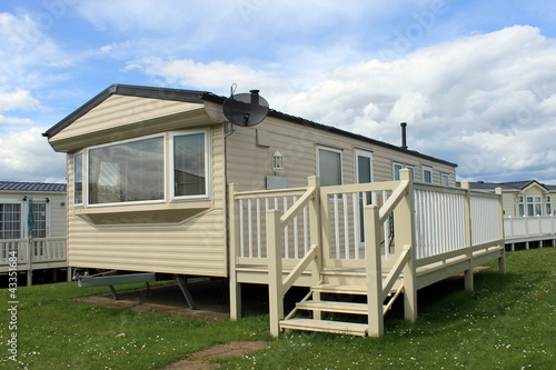 Mobile caravans or trailers in modern holiday park - 43351684