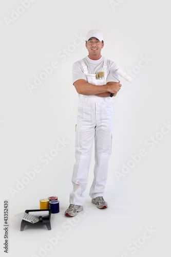 Full-length portrait of a painter with his tools