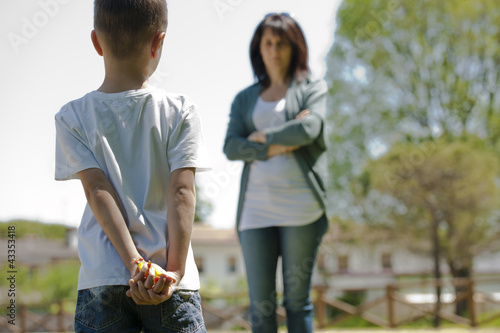 Little boy hiding candies