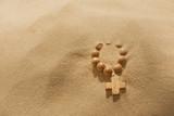 Losing faith rosary on desert religion  symbol metaphor poster