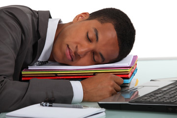Businessman asleep at desk