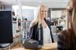 Woman At Cash Counter