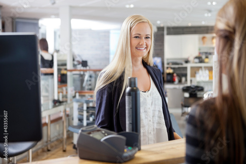 Woman At Cash Counter