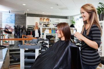 Hair Dresser with Customer in Beauty Salon