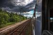 Dark rain clouds accompanying the train.