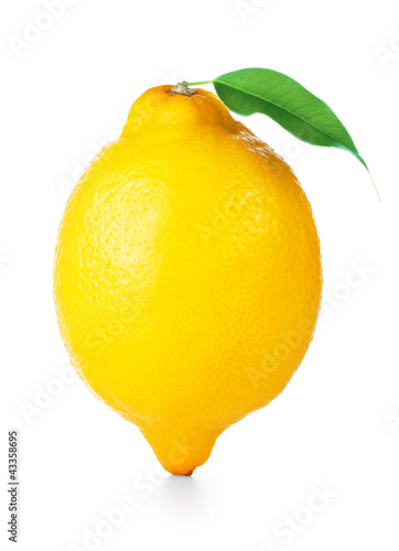 Single ripe lemon with green leaf isolated on white background