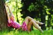 girl lying under a tree