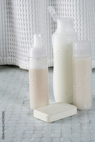 Soap and bottles shampoo, conditioner and shower gel