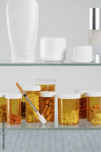 Medicine cabinet with  pill bottles and syringe