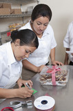 Hispanic bakers working in commercial kitchen