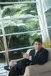 Hispanic businessman sitting in chair talking