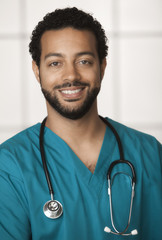 Smiling mixed race doctor in scrubs