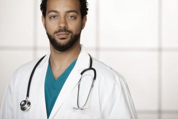Serious mixed race doctor in lab coat