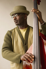 Black musician playing double bass