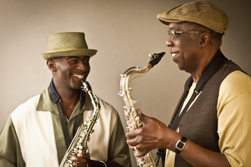African American musicians playing saxophones together
