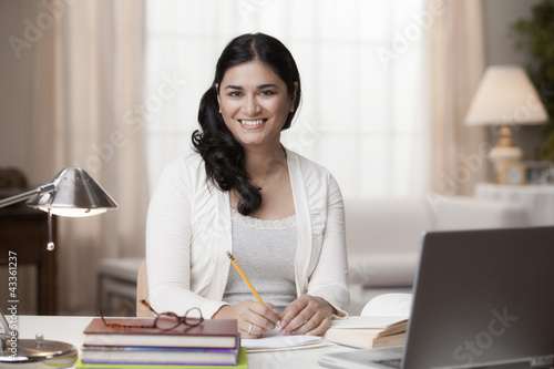Mixed race woman studying