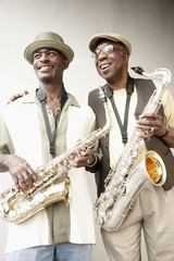 African American musicians holding saxophones
