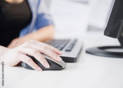 Close up of Korean woman using computer mouse