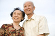 Smiling senior Chinese couple