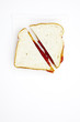 One peanut butter and jelly sandwich cut in half