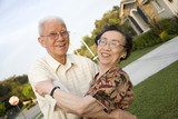 Senior Chinese couple hugging outdoors