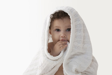 Mixed race baby girl wrapped in a blanket