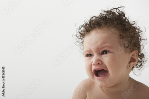 Crying mixed race baby girl