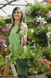 Caucasian woman working in plant nursery