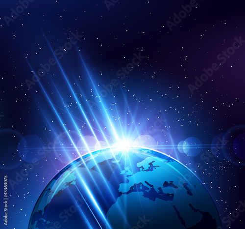 Planet earth in the bright rays of light. Vector