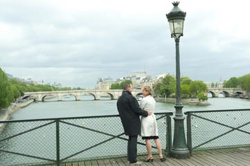 Caucasian couple talking on bridge