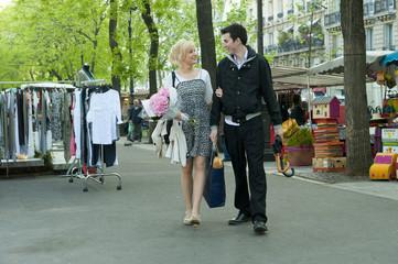 Caucasian couple at market
