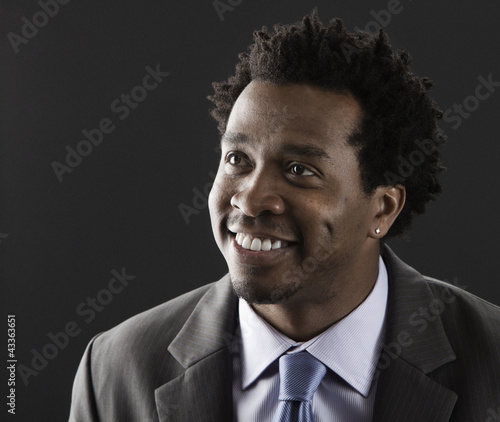 Smiling Black businessman in suit