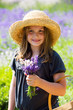 Cute young girl in a field of purple lavender