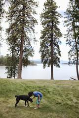 Caucasian boy petting dog
