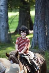 Caucasian boy riding a horse