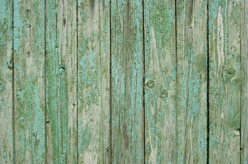 Wooden fence with traces of old paint.
