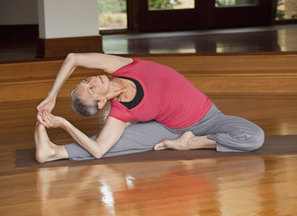Senior Caucasian woman practicing yoga