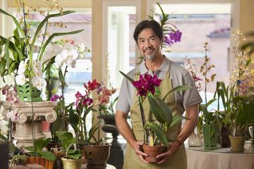 Japanese florist holding exotic flower