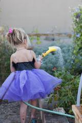 Caucasian girl watering garden