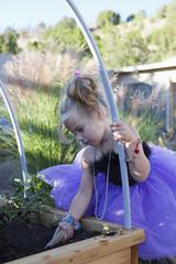 Caucasian girl working in garden