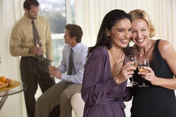 Smiling couples enjoying party
